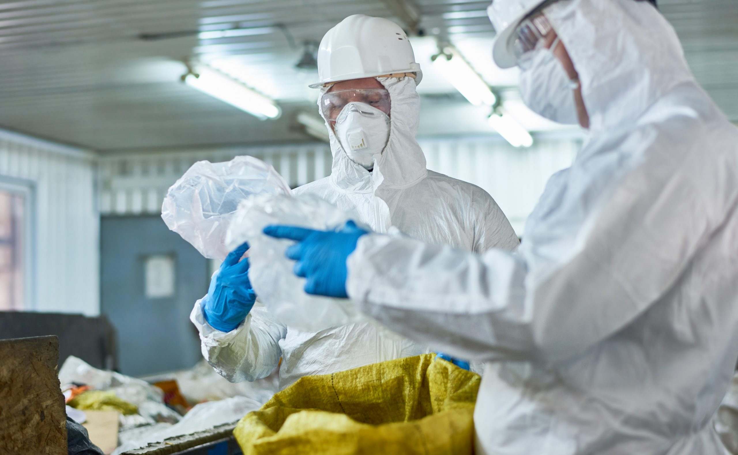 Workers Sorting Plastic on Modern Waste Processing Plant